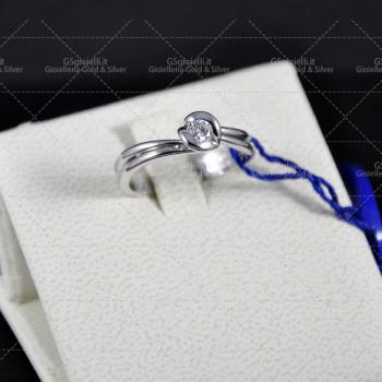 Anello Damiani solitario diamante taglio brillante ct.0.14 colore H if, oro gr.4.80